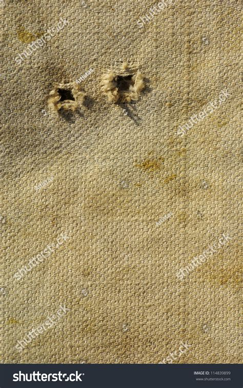 fabric pattern with holes old textured canvas background worn tattered stock photo