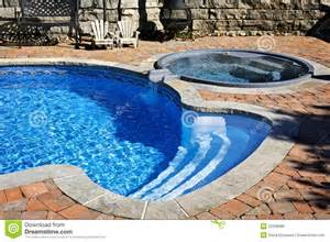 Landscaped Backyard Swimming Pool With Tub Royalty Free Stock Image