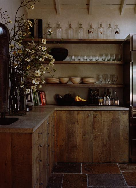 reclaimed wood kitchen cabinets rustic village kitchen stone flooring reclaimed wood