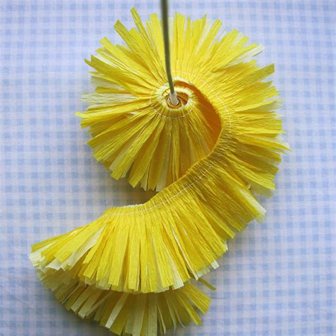 crepe paper flowers using streamers and a ruffler foot