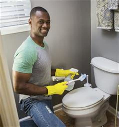 man cleaning bathroom cleaning tips for renters