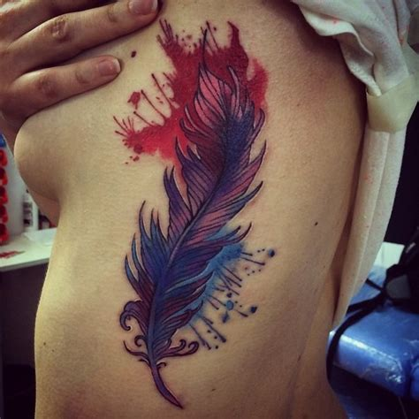 wonderful colorful feather with splashes tattoo on side