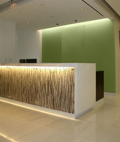 built in reception desk backlit reception desk with absolute white stone top