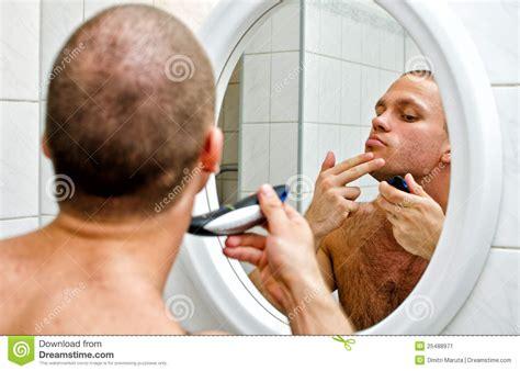 shaving in the bathtub male shaving in bathroom stock image image 25488971