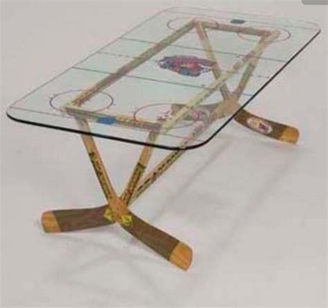 hockey stick coffee table hockey stick coffee table with rink printed on glass top