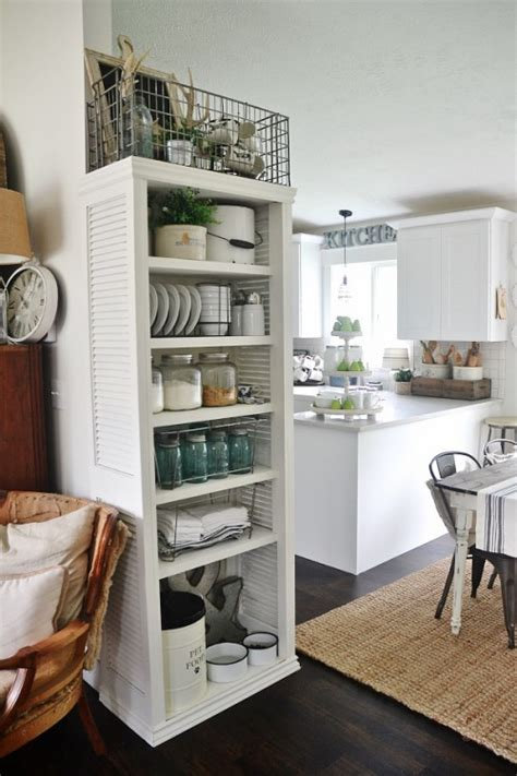 kitchen bookshelf ideas diy kitchen bookshelf with shutter doors shelterness