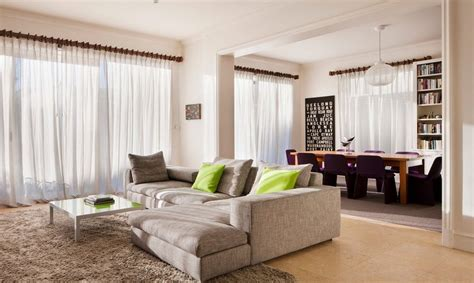 neutral living room with pops of color how to use neutral colors without being boring a room by