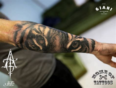 eye of the tiger tattoo arm tiger by agat artemji best ideas