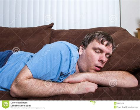guy on a couch sleeping man royalty free stock image image 35179436