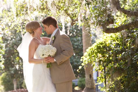Garden Wedding Attire For Groom Blushing And Groom Pose For S Photos