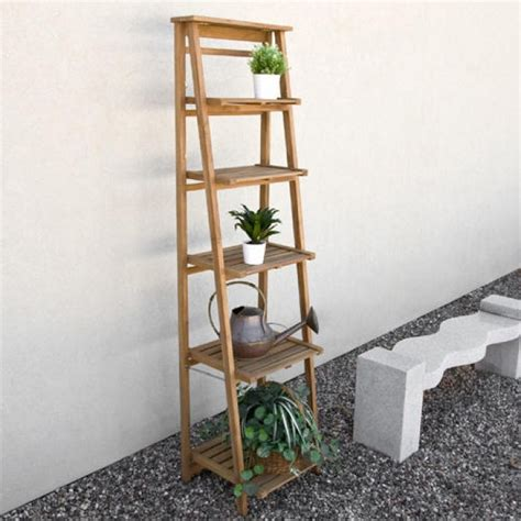 oversized ladder style teak plant stand planters and