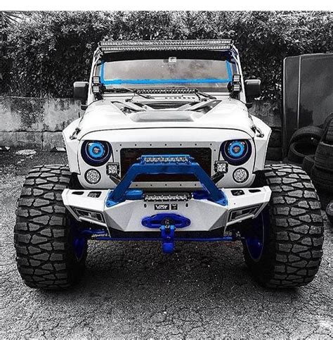 white and blue jeep white jeep jk with blue trim and nitto mud grappler tires