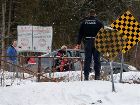 Crossing Border Into Us From Canada With Criminal Record Canada S Border Sees Surge In Families Others Crossing