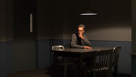 shoots himself in in interrogation room waits in an interrogation room a middle aged has a time waiting to be questioned