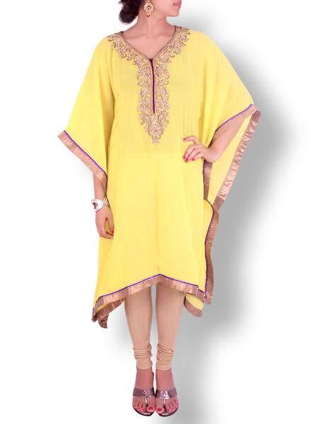 yellow kaftan with pearl work with golden trims