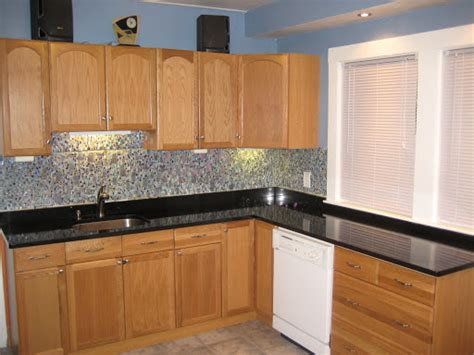 Countertops With Oak Cabinets by Black Granite Countertops With Oak Cabinets Granite