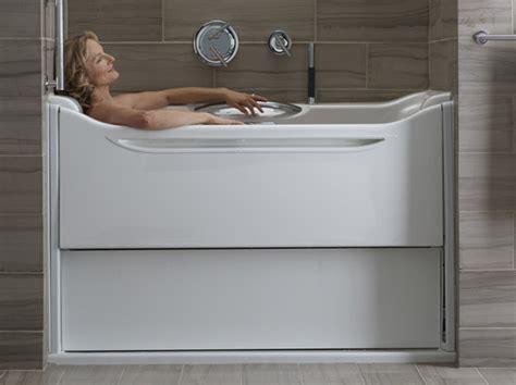 kohler walk in bathtubs elevance rising wall bathtub by kohler