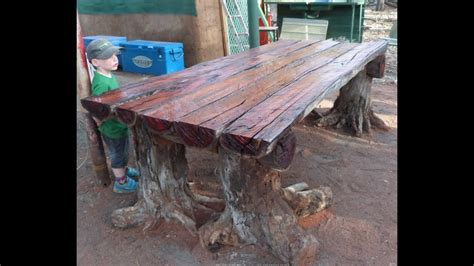 chainsaw    rustic log furniture table