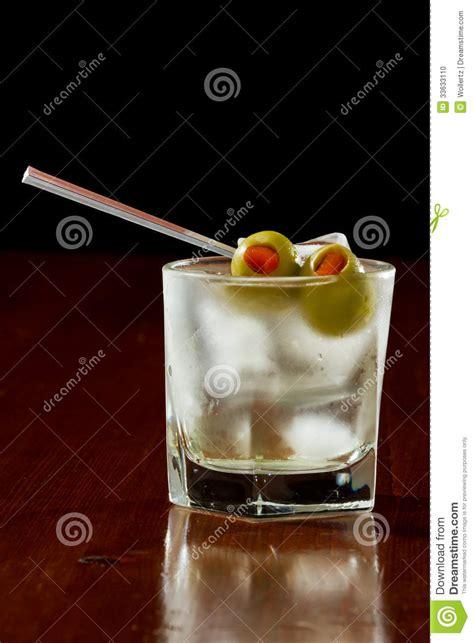 martini rock dirty vodka martini stock photo image of orange liquid