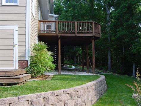 sloped backyard deck ideas 17 best images about sloped back yard ideas on pinterest