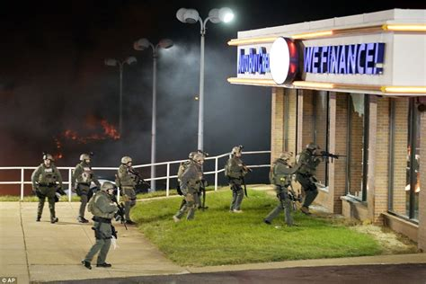 cops armed in riot gear arrive at walmart ferguson missouri burns as darren wilson will not