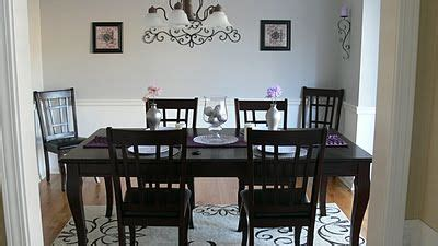 dining room  grey walls wainscoting  medium wood