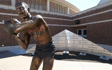 statue honors legacy  leadership  basketball coach
