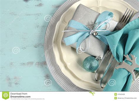christmas table place settings  aqua blue silver  white stock photo image  merry