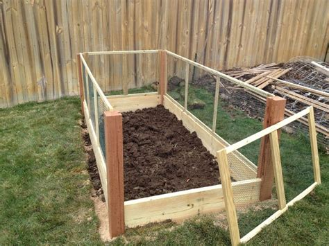 raised garden bed with fence rabbits raised bed garden installed next to my existing