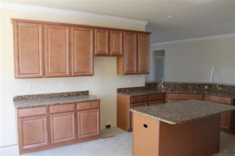 is it hard to install kitchen cabinets install cabinets before or after flooring america s