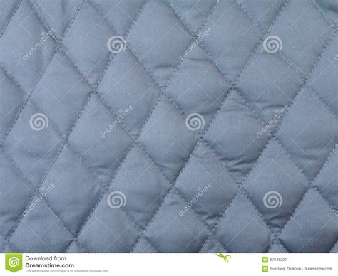 grey quilted wallpaper rhombus quilted cloth background stock photo image 67646227