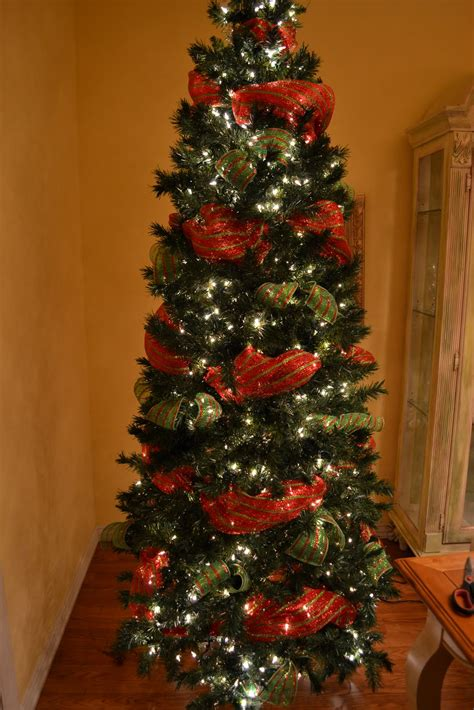 how to wrap ribbon around the christmas tree tree with mesh ribbon design