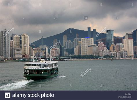 ferry boat victoria ferry boat in victoria harbor hong kong before storm