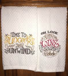 pair of embroidered kitchen dish towels wine lover