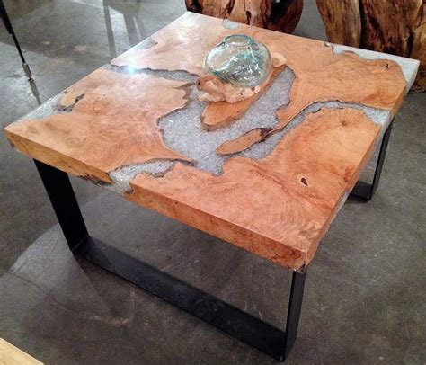 Tree Trunk Glass Coffee Table A Coffee Table Made From Reclaimed Growth Teak Tree Trunk Sections Broken Glass And Resin