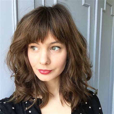 medium haircut with bangs 70 brightest medium length layered haircuts and hairstyles