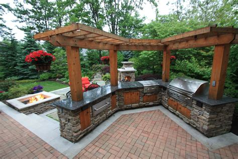 outdoor pergolas covered outdoor kitchen weatherproof pergola over an outdoor kitchen by the pattie group