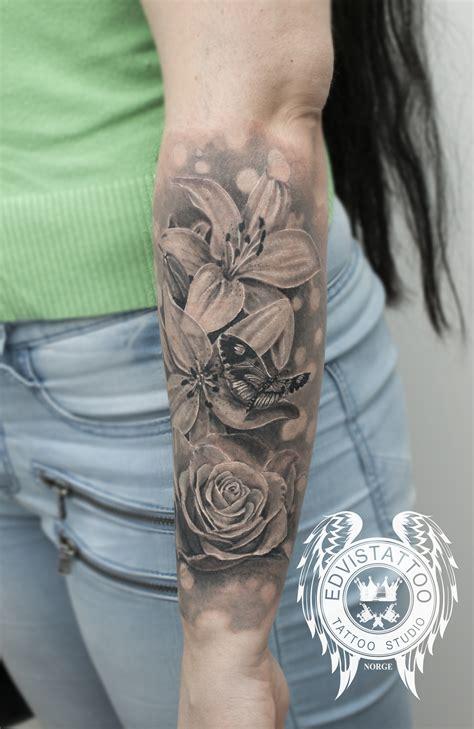 roses and lilies tattoos edvinas levendauskas certified artist