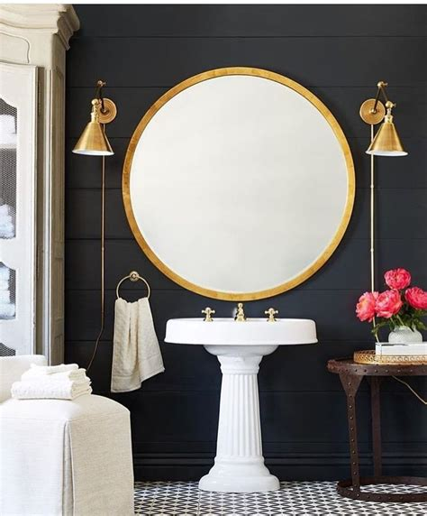 Gorgeous Gold Round Mirror And Brass Wall Sconces In This Gold Bathroom Mirror