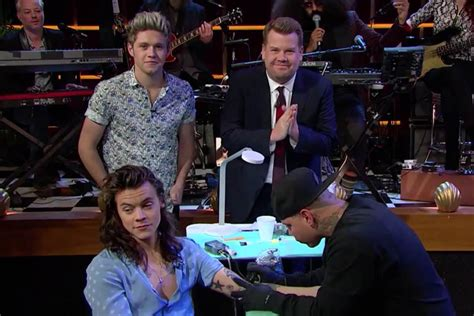 harry styles gets tattoo on james corden show one direction s harry styles gets tattoo live on james