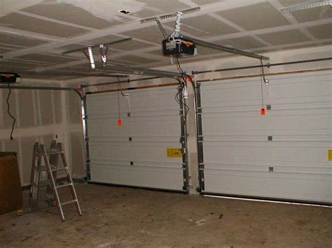 How To Install Garage Door Springs Overhead Garage Door Installation Garage Door Torsion Replacement In
