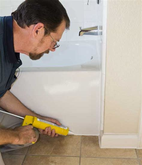 caulking the bathtub caulking a shower or tub on the house