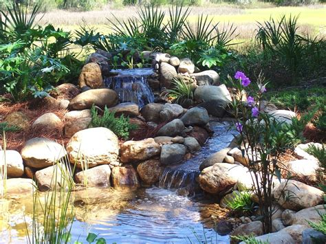 how to create a pond and stream for an outdoor waterfall pond with waterfall and stream island garden features