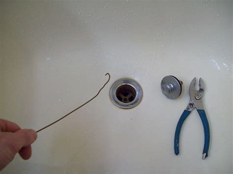 unclog bathtub drain hair 7 ways to unclog a bathtub networx