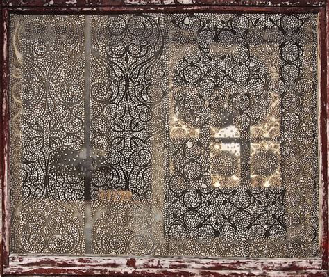 pattern book for the artist blacksmith artist delicately burns intricate lace like patterns to
