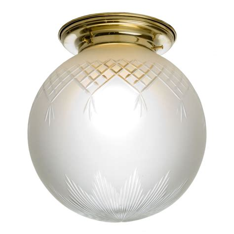 flush fitting globe glass ceiling light fixed to gold