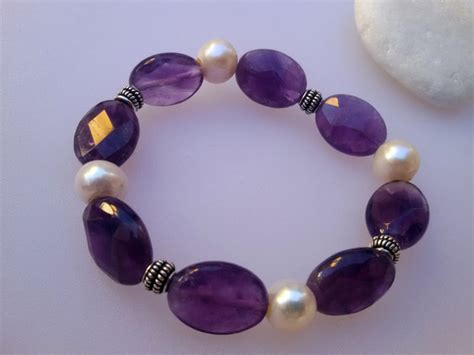 Sterling silver bracelet, faceted amethyst gemstones and natural pearls.   45 eur.   Jewellery