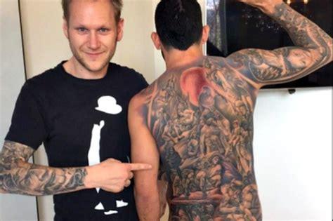 tattoo messi braccio tevez tatuaggio infernale sulla schiena