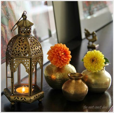 Decorative Ornaments For The Home antique brass kundas with single stems of dahlias tucked