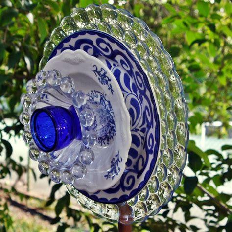 garden flower blue glass plate flower garden yard